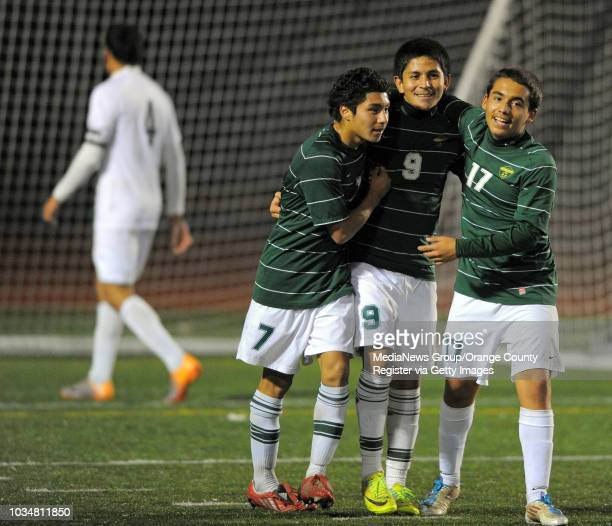 Narbonne beat North High 3-2 to advance to the championship game in the South High boys soccer tournament. Narbonne's Alfonso Moreno, center, is...