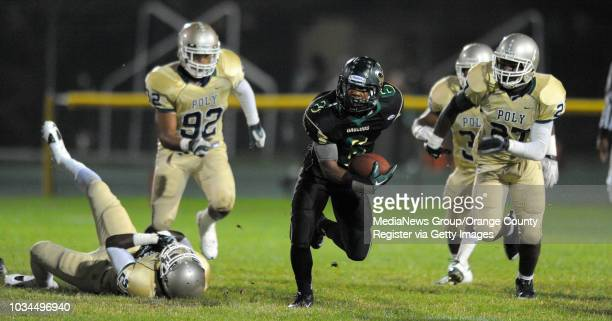 CITY 09/17/10 Narbonne vs Long Beach Poly nonleague football 1st half Narbonne's Noel Rankins breaks through for an 80yard TD run as the Poly...