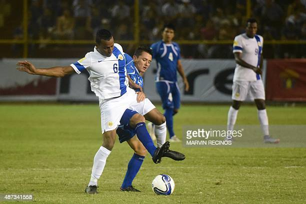 Narciso Orellana of the National football Team of El Salvador fights for the ball against Jeremy de Nooijer of the National selection of Curazao at...