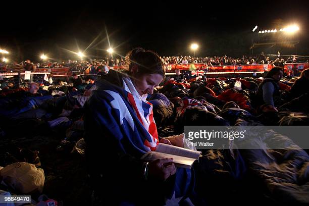 Narelle Marson from Melbourne Australia reads her book as she camps overnight at ANZAC Cove before the Dawn Service on April 25 2010 in Gallipoli...