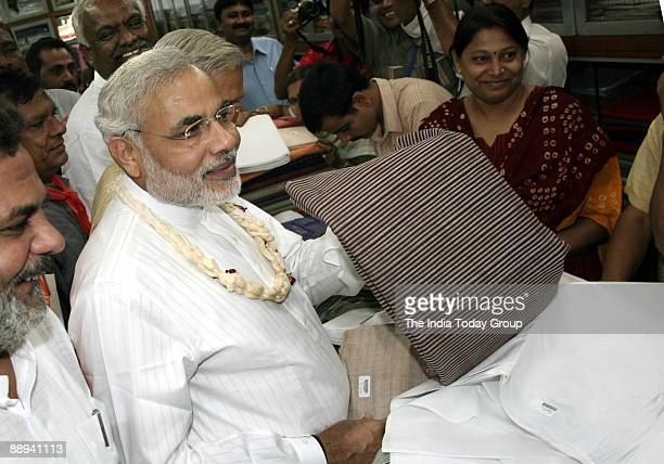 Narendra Modi Chief Minister of Gujarat purchasing the Khadi in Ahmedabad Khadi Bhandar in Gujarat India