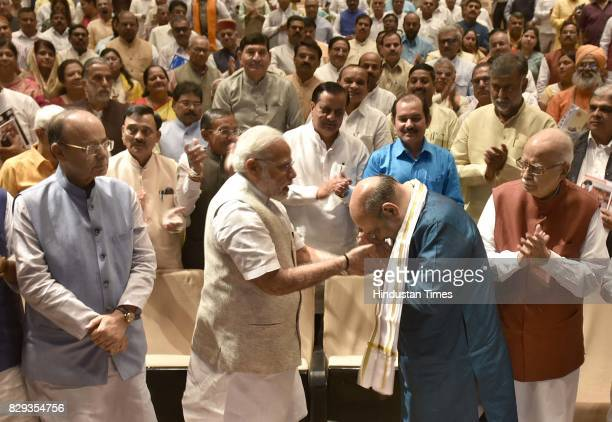 Narendra Modi felicitates BJP President Amit Shah before the start of Parliamentary Meeting during the Monsoon Session at Parliament on August 10...