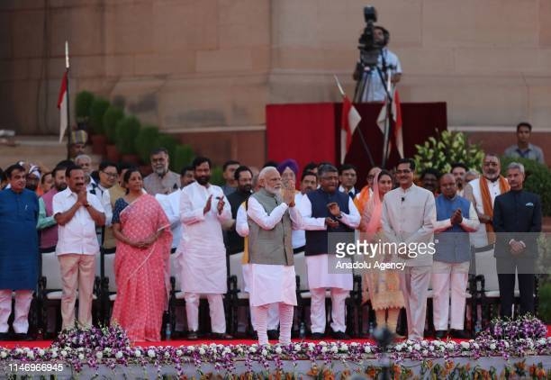 Narendra Modi gestures after the swearingin ceremony at the presidential palace in New Delhi India 30 May 2019