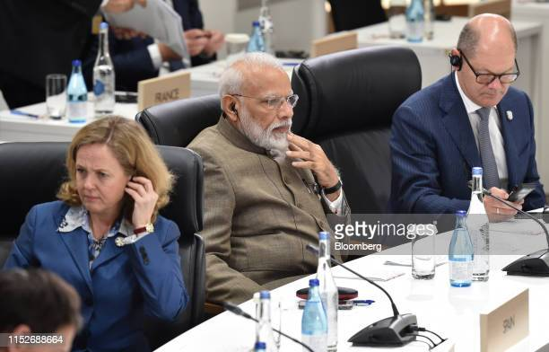 Narendra Modi, India's prime minister, center, and Olaf Scholz, Germany's finance minister, right, attend a session at the Group of 20 summit in...