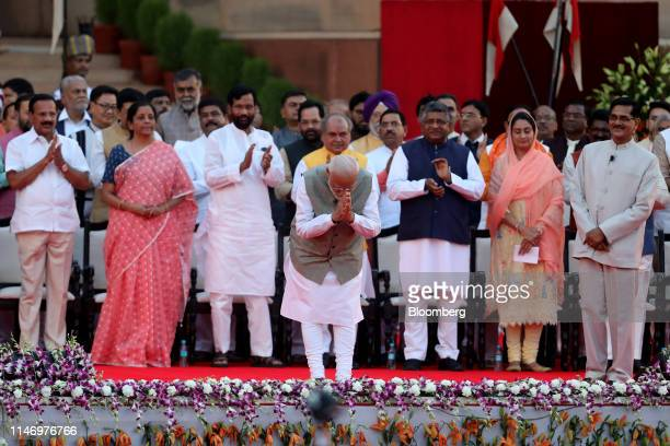 Narendra Modi India's prime minister center gestures during a swearing in ceremony for the prime minister and other members of the cabinet at the...