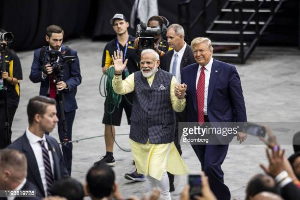 Narendra Modi India's prime minister center left and US President Donald Trump hold hands while leaving the Howdy Modi Community Summit in Houston...