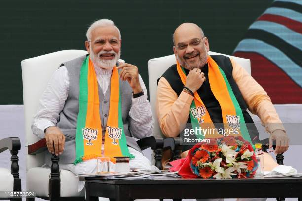 Narendra Modi India's prime minister left and Amit Shah president of the Bharatiya Janata Party attend an event marking the release of the BJP...