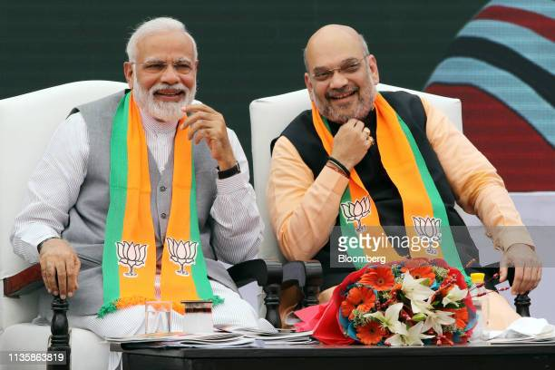 Narendra Modi India's prime minister left and Amit Shah president of the Bharatiya Janata Party attend an event marking the release of the Bharatiya...