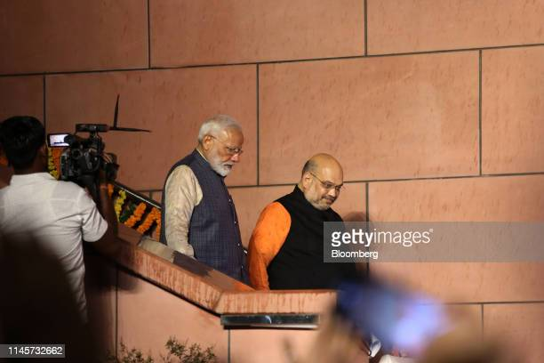 Narendra Modi India's prime minister left and Amit Shah president of the Bhartiya Janata Party arrive for an event at the party's headquarters in New...