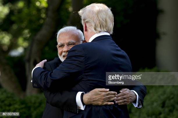 Narendra Modi India's prime minister left hugs US President Donald Trump during a joint statement in the Rose Garden of the White House in Washington...