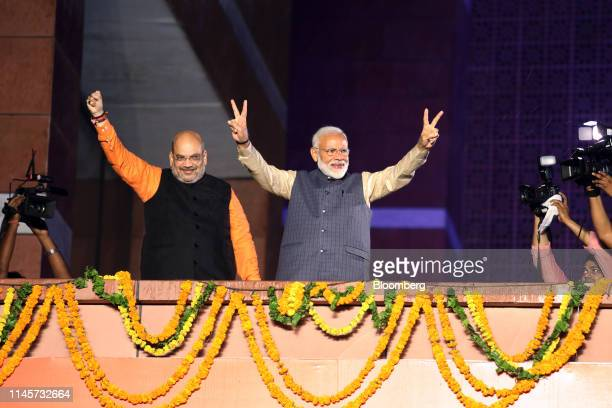 Narendra Modi India's prime minister right and Amit Shah president of the Bhartiya Janata Party celebrate during an event at the party's headquarters...