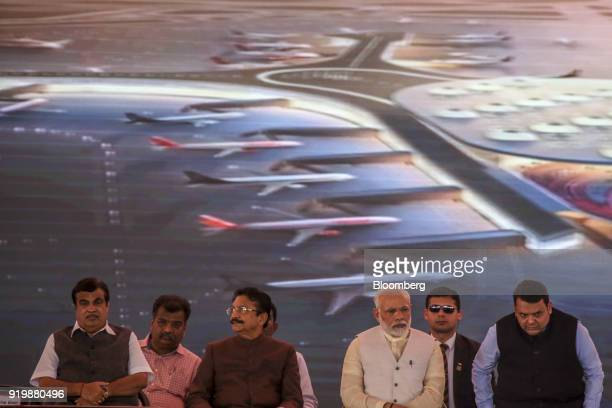 Narendra Modi India's prime minister third from right attends a ceremony at the site of the new Navi Mumbai International Airport in Navi Mumbai...