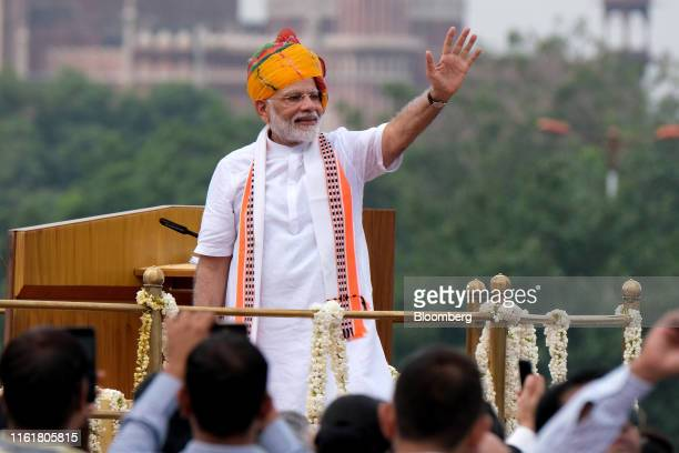 Narendra Modi, India's prime minister, waves after delivering a speech during an event celebrating the nation's Independence Day at Red Fort in New...