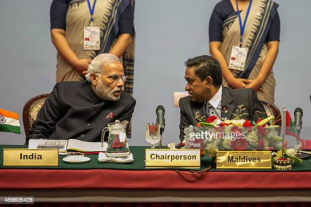 Narendra Modi Prime Minister of India speaks to Abdulla Yameen President of the Maldives during the inaugural session of the 18th SAARC Summit on...
