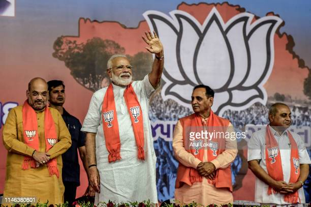 Narendra Modi waves to the supporters from the public rally May 26 2019 in Ahmedabad India Naredra Modi addressed his first rally in Ahmedabad after...