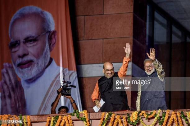 Narendra Modi waves to the victorious party workers at the BJP party head quarters in New Delhi India Indian Prime Minister Narendra Modis Bharatiya...