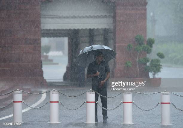 Rain water logged at the premises of Parliament building pumped out using heavy pumps after monsoon rain spell during Monsoon Session of Parliament...