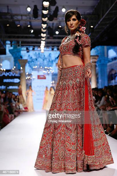 Nargis Fakhri walks the runway during the Suneet Varma show on day 4 of Lakme Fashion Week Summer/Resort 2015 at Palladium Hotel on March 21 2015 in...