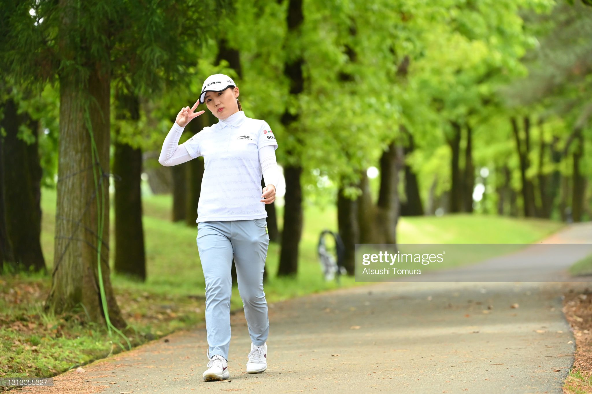 https://media.gettyimages.com/photos/nari-lee-of-south-korea-poses-on-her-way-to-the-17th-tee-during-the-picture-id1313055327?s=2048x2048