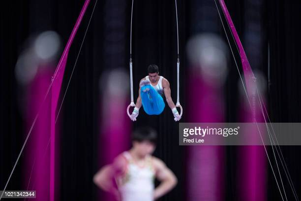 Nariman Kurbanov of Kazakhstan competes on the Horizontal Bar during on the Rings during the Artistic Gymnastics of the Men's Team Final at the...