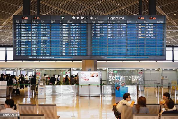 narita airport departure board - narita international airport stock photos and pictures