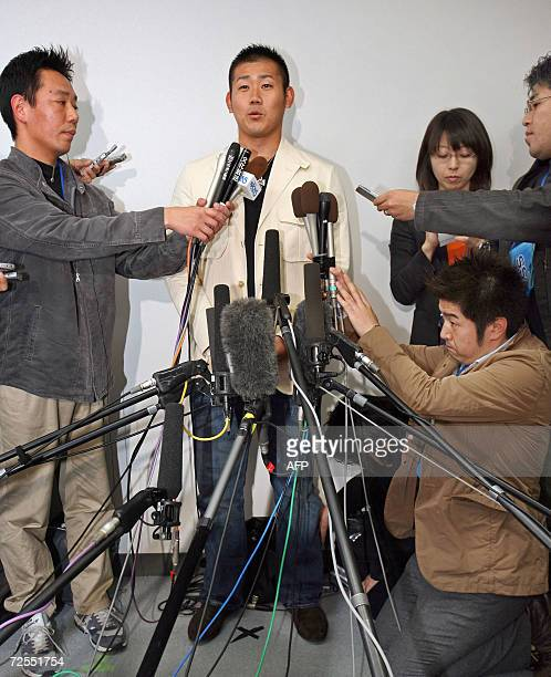 Japanese Seibu Lions pitcher Daisuke Matsuzaka speaks at a press conference at Narita Airport in Chiba prefecture suburban Tokyo before leaving to...
