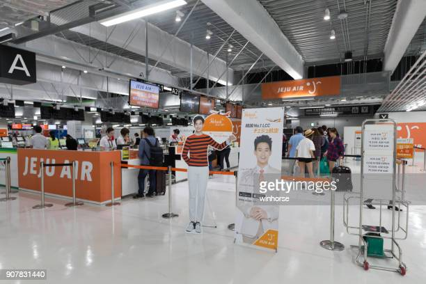 narita international airport terminal 3 - jeju stock photos and pictures