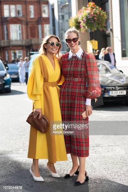 Narmina Marandi wears an Emilia Wickstead dress with the Founder of Koibird Belma Gaudio wearing an Emilia Wickstead dress and Moni earrings during...