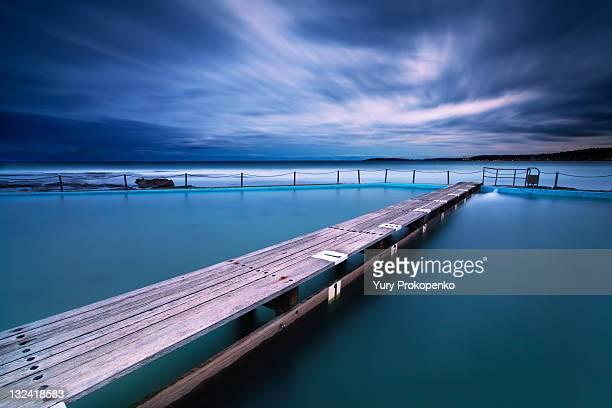 narrabeen tidal pool by night, sydney, australia - sydney ストックフォトと画像