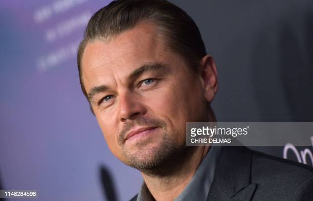 Narrator and producer US actor Leonardo DiCaprio attends the Los Angeles premiere of HBO documentary Ice on Fire at LACMA in Los Angeles on June 5...