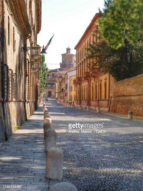narrow alley along buildings - ferrara stock pictures, royalty-free photos & images