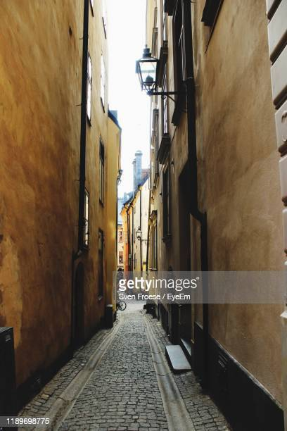 narrow alley along buildings - narrow stock pictures, royalty-free photos & images