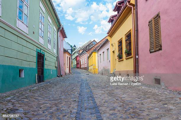 narrow alley along buildings - lutai razvan stock pictures, royalty-free photos & images
