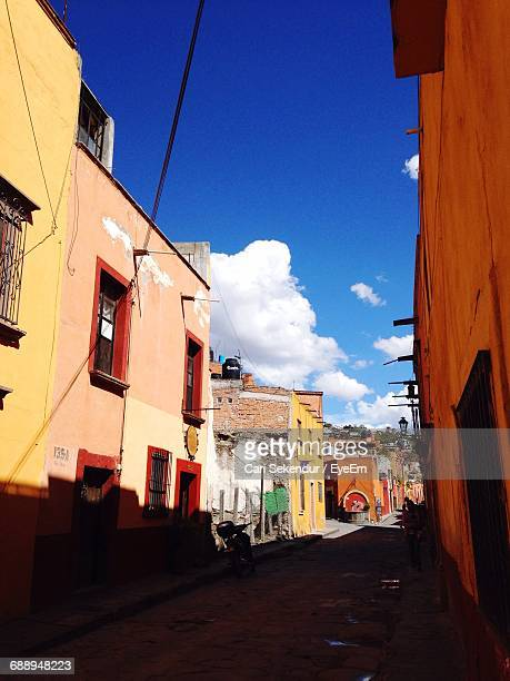 narrow alley along buildings - cari stock pictures, royalty-free photos & images
