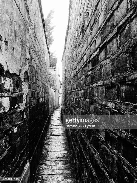 Narrow Alley Along Walls