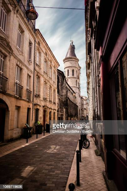 narrow alley amidst buildings in city - christian soldatke stock pictures, royalty-free photos & images