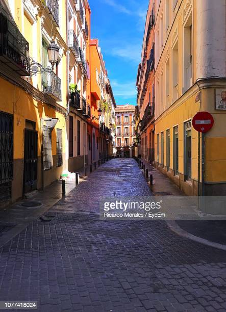 narrow alley amidst buildings in city - narrow stock pictures, royalty-free photos & images