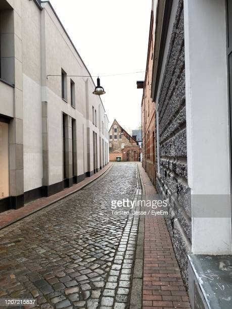 narrow alley amidst buildings in city - jesse stock pictures, royalty-free photos & images
