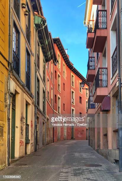 narrow alley amidst houses in town - oviedo stock pictures, royalty-free photos & images
