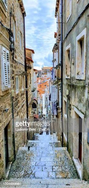 narrow alley amidst old buildings in city - ljubomir belic stock pictures, royalty-free photos & images