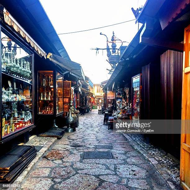 narrow alley amidst stores at bascarsija - sarajevo stock-fotos und bilder