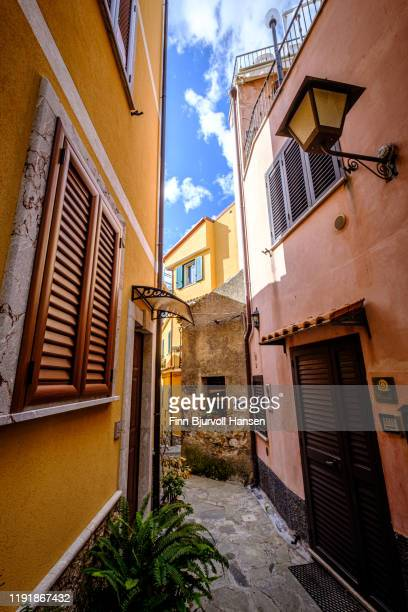 castelmola, taormina, italy - november 8, 2019: narrow alley and old houses with plants outside in castelmola - finn bjurvoll stock pictures, royalty-free photos & images