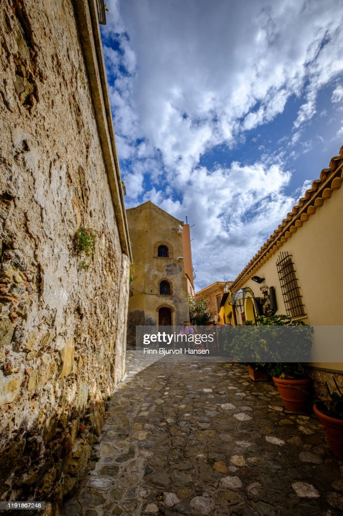 Narrow alley and old houses with plants outside in Castelmola Taormina Sicily Italy : Stock Photo