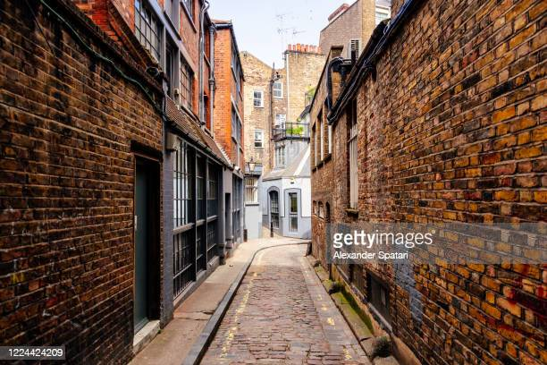 narrow alley in fitzrovia, london, uk - village stock pictures, royalty-free photos & images