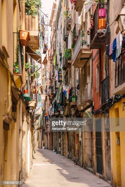 narrow alley in gothic quarter, barcelona, spain - barcelona spain stock pictures, royalty-free photos & images