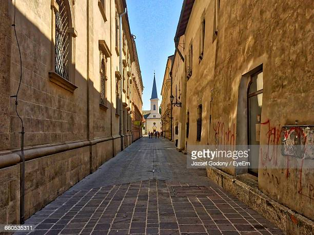 narrow alley in old town - kosice stock photos and pictures