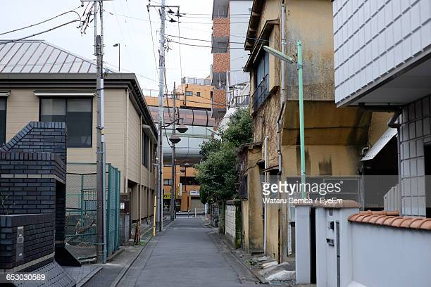 narrow alley with buildings in background - alley stock pictures, royalty-free photos & images