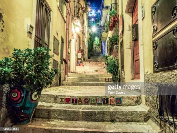 Narrow alleyway of stone steps in Taormina.
