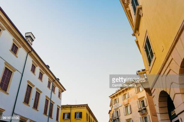 narrow and colorful street (old town) in verona, italy - {{relatedsearchurl('london eye')}} stock photos and pictures