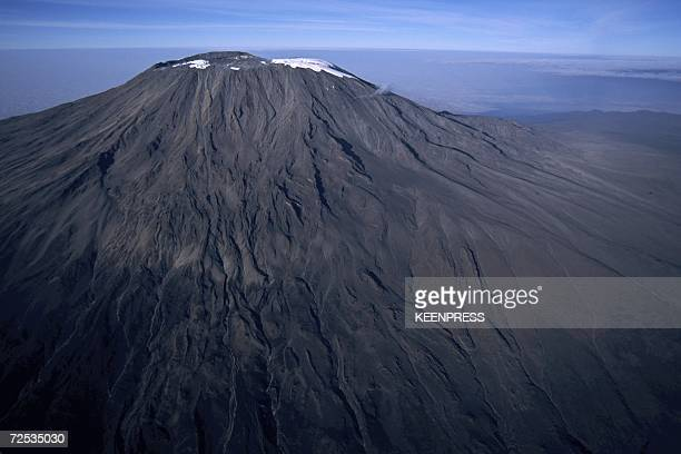 Narrow band of snow adorns the summit of Africa's highest peak, Mount Kilmanjaro in this aerial photo taken in August 2003 in Tanzania. The peak...